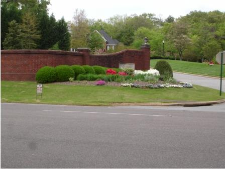 Landscaping an entryway can bring many new lawn care customers. (Free Advertising)