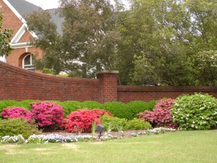 Landscaping a subdivision entryway is free advertising for your lawn care business.