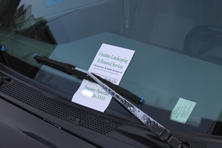 lawn care business flyer under windshield wiper